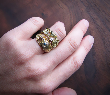 18K poppy eternity ring and peacock feather ring (with blue diamond)