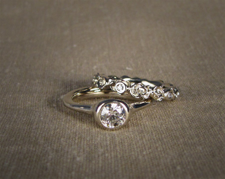 18K white gold diamond solitaire with carved rose eternity band