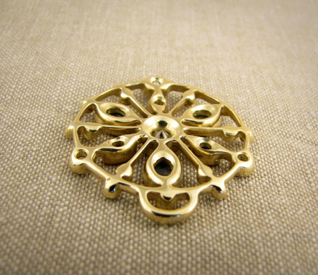 back of 18K yellow gold opal and diamond mandala pendant