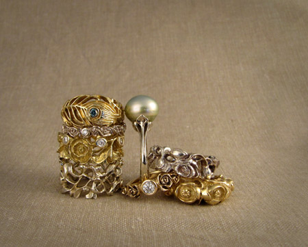 18K white and yellow gold, palladium, pearl, & diamond rings