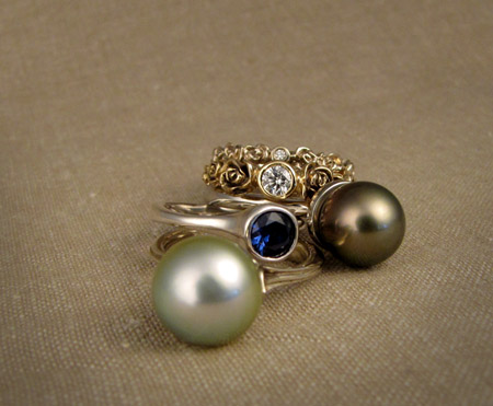 18K gold, palladium, pearl, sapphire, and diamond rings