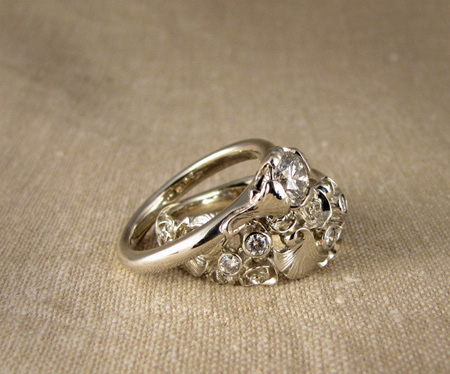 Carved band with roses and ginkgo leaves and diamonds; 14K white gold