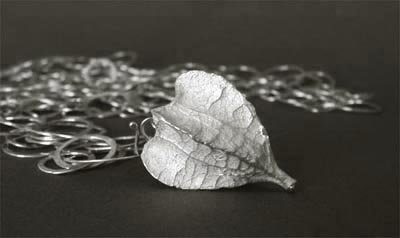 Cast silver hollow seedpod w/hammered chain