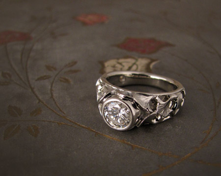 Carved ginkgo leaf and diamond solitaire, 18K white gold