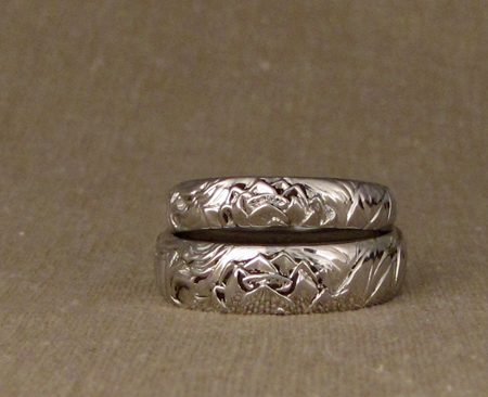 Carved storybook wedding bands - Platinum
