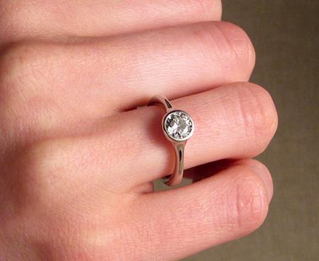 Low-profile solitaire engagement ring in palladium