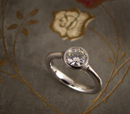 Low-profile solitaire engagement ring in palladium