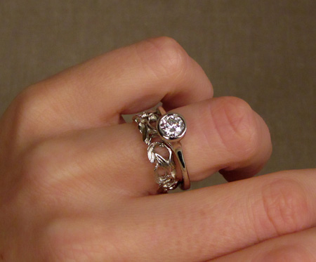 14K solitaire paired with mistletoe band