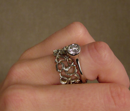 14K white gold solitaire and wide mistletoe band