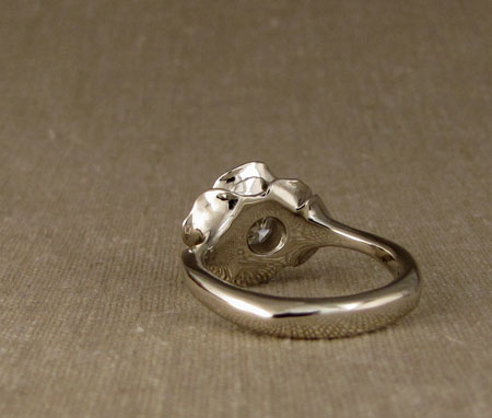 Carved blooming rose solitaire with diamond; 14K white gold
