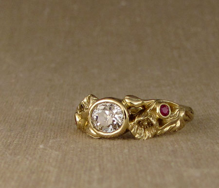 Carved Poppy ring with oval diamond and rubies, 18K