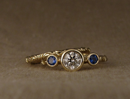 Victorian solitaire with diamond and sapphires