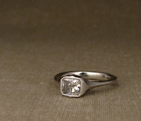 Art Deco-style platinum solitaire with radiant diamond