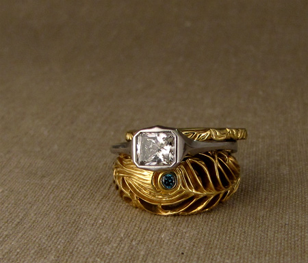 Art Deco-style platinum solitaire with 18K yellow Peacock feather ring