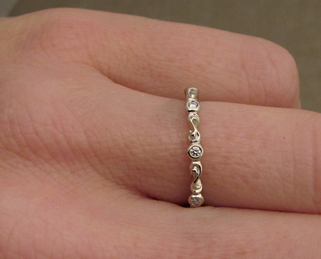 Carved Solitaire & Eternity Band with diamonds, 18K white gold