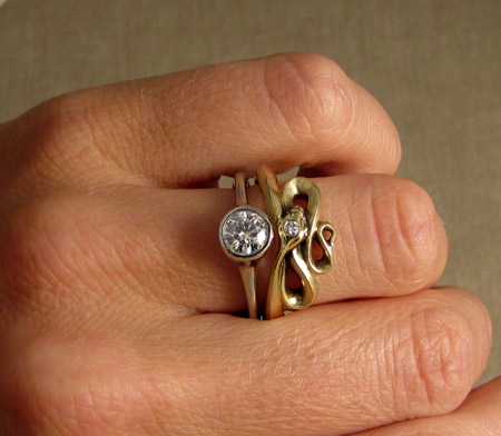 18K snake ring with diamond solitaire