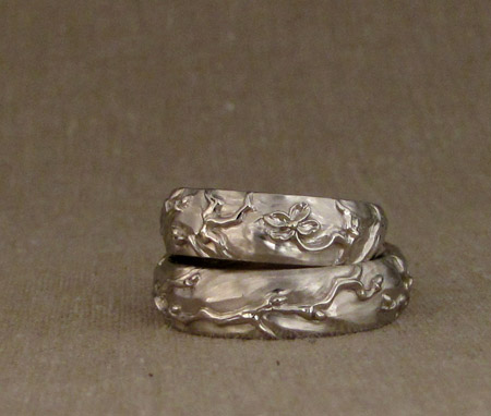Hand-carved dogwood + sparrow wedding bands