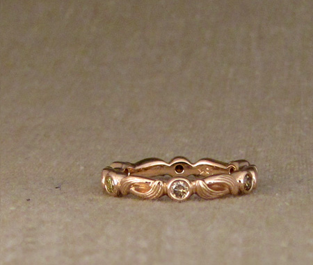 Arabesque eternity band in 18K rose gold with golden-orangey diamonds