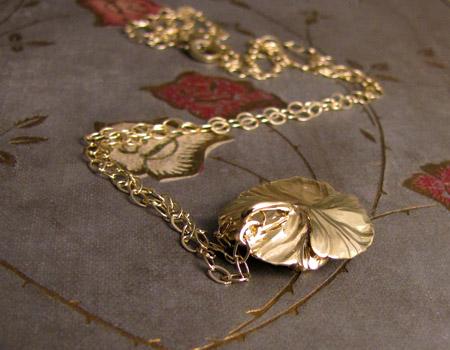 18K carved poppy pendant
