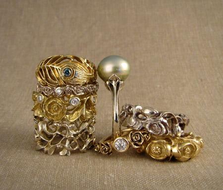 Custom carved pile of 18K diamond Tahitian pearl rings