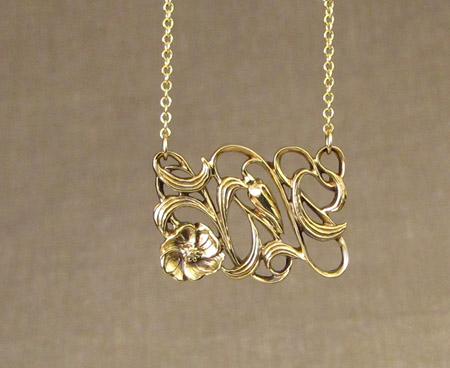 hand-carved 18K art nouveau floral pendant