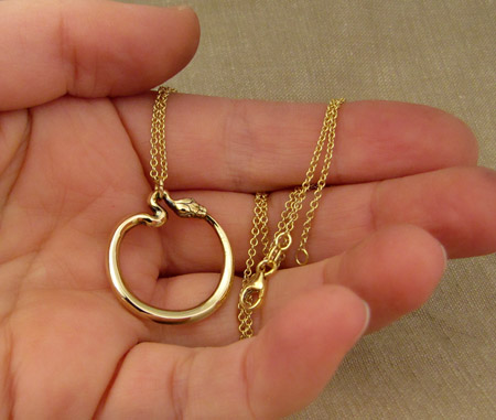 Hand-carved ouroboros pendant in 14K