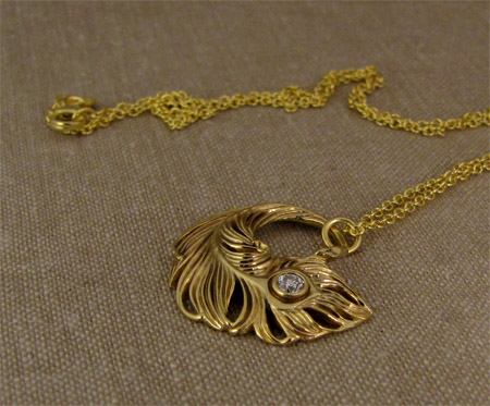 Hand-carved peacock feather pendant in 18K with 3mm OEC diamond