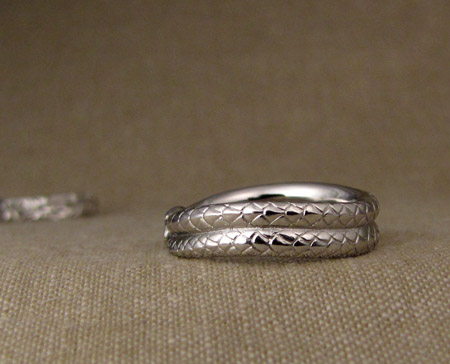 Hand-carved ouroboros wedding band, platinum