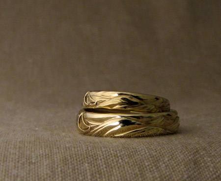 Hand-carved sailboat wedding bands