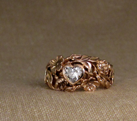 Hand-carved wild rose solitaire with heart diamond, rose gold