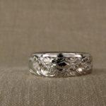 Custom-carved ocean waves wedding bands
