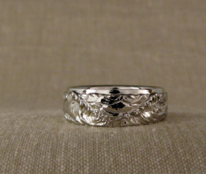 Custom-carved ocean waves wedding bands