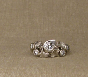 Custom carved ginkgo leaves and pear diamond ring