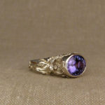 Hand-carved Tanzanite solitaire with poppy motif, 18K