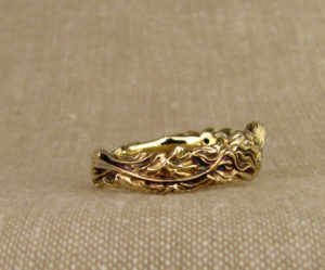 Hand-carved mermaid ring with blue diamonds, 14K gold