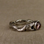 Hand-carved snake solitaire with sapphire