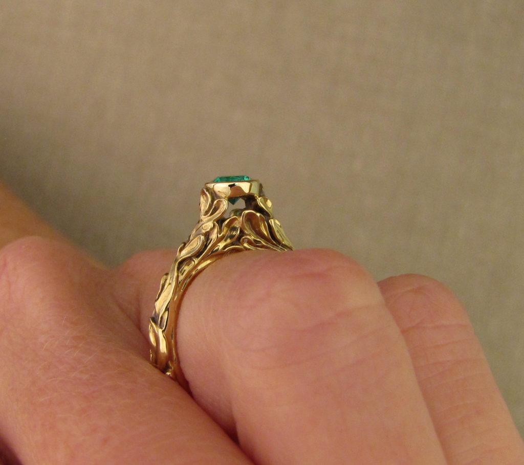 Hand-carved Rococo Leaves Emerald Solitaire in 18K gold