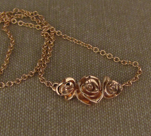 Hand-carved rose choker in rose gold