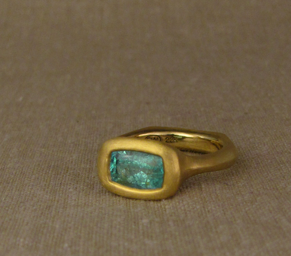 22K + Pariaba Tourmaline solitaire, hand-carved