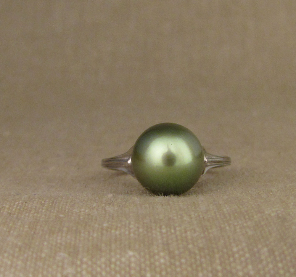 Hand-carved Tahitian green pearl ring in platinum