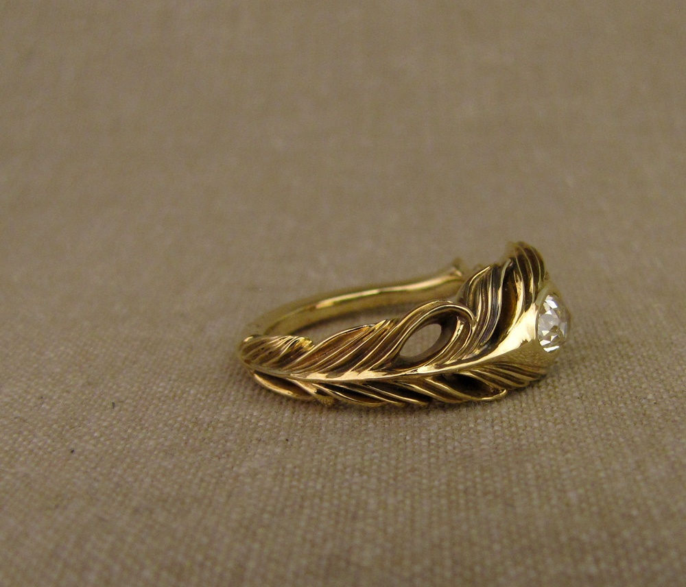 Custom-designed & hand-carved peacock feather ring with an antique pear diamond, 18K gold