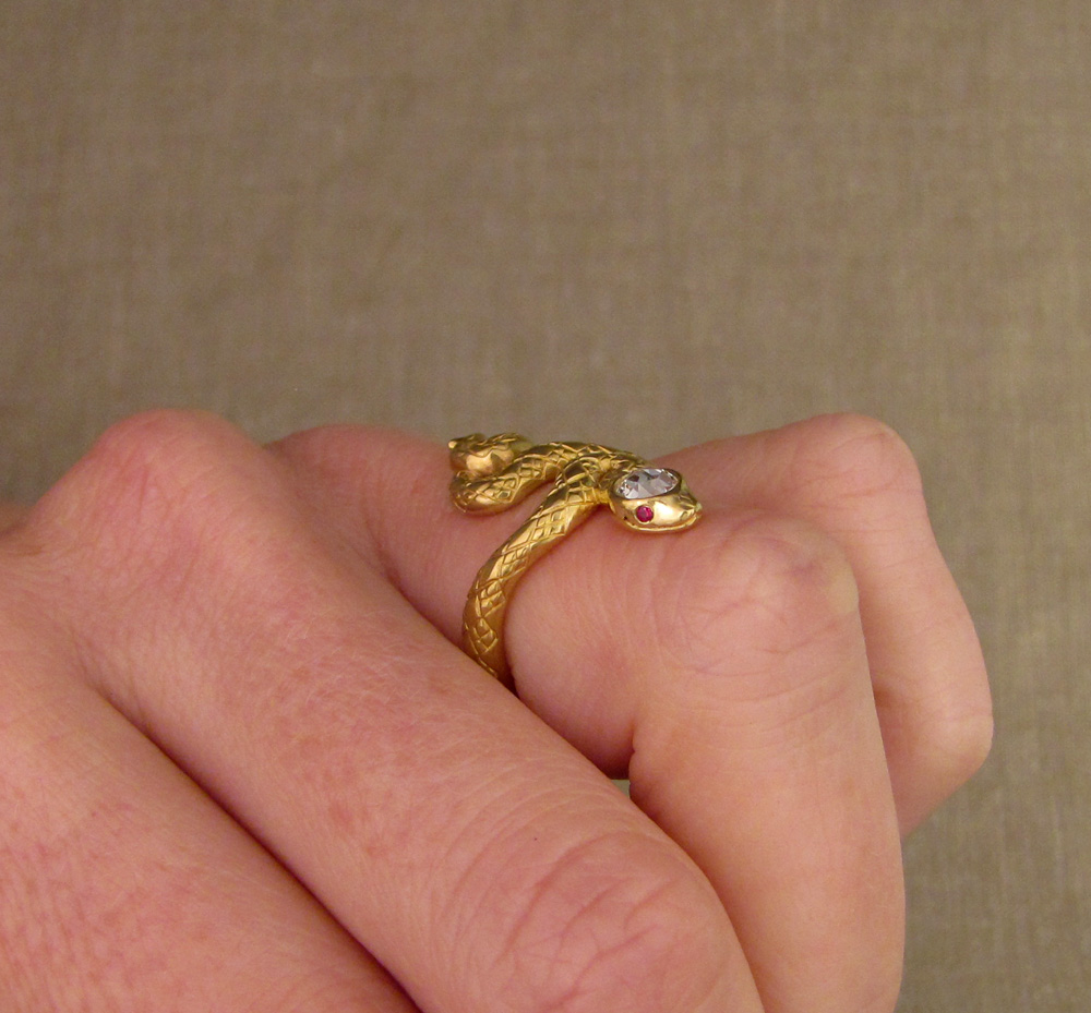Custom designed & hand-carved snake ring with diamond head and ruby eyes, 22K gold