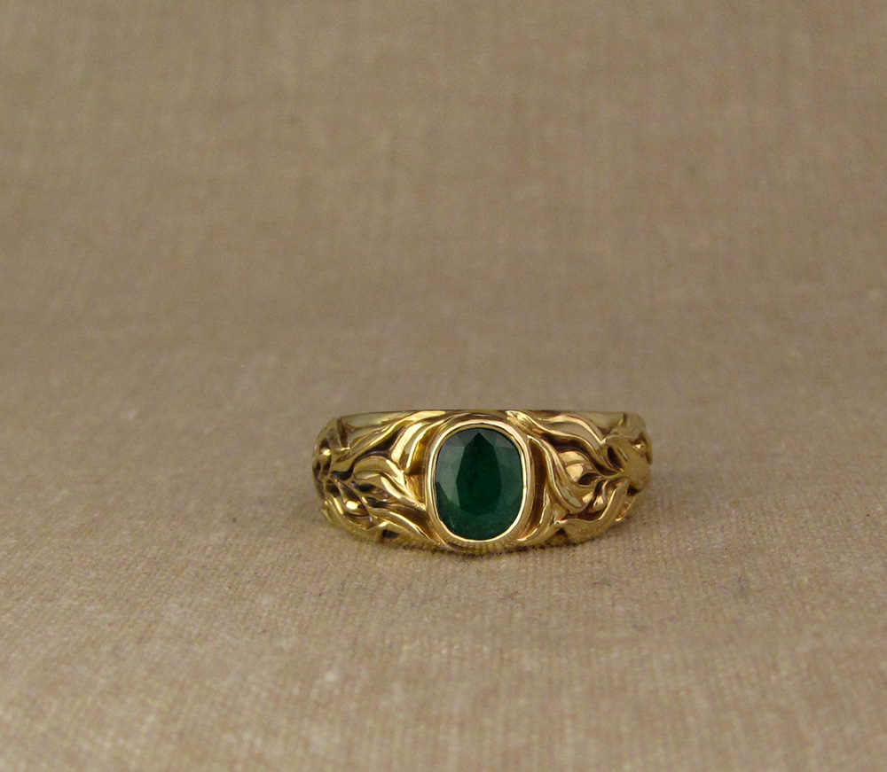 Custom designed & hand-carved Laurel motif Emerald Solitaire in 18K gold