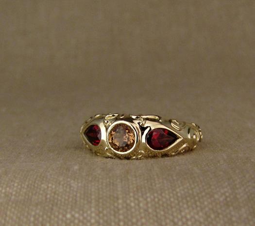 Custom designed & hand-carved arabesque motif 3-stone ring, 14K and garnets