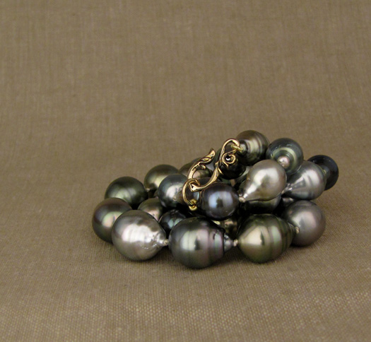 Baroque Tahitian pearls with hand-carved custom hook clasp, 14K gold