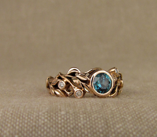 Custom designed & hand-carved blue zircon solitaire in rose gold