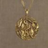 asclepius and magnolia pendant