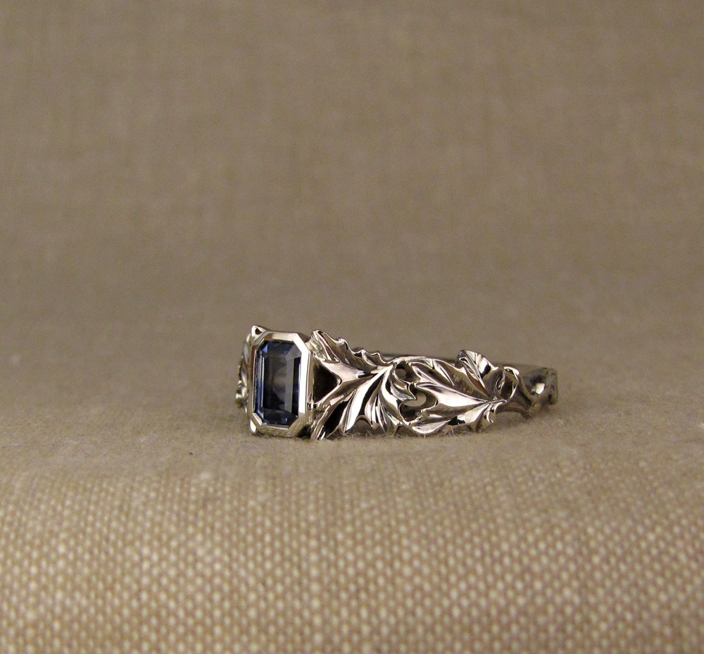 Custom designed & hand-carved maple solitaire with bi-color blue sapphire, 14K white gold