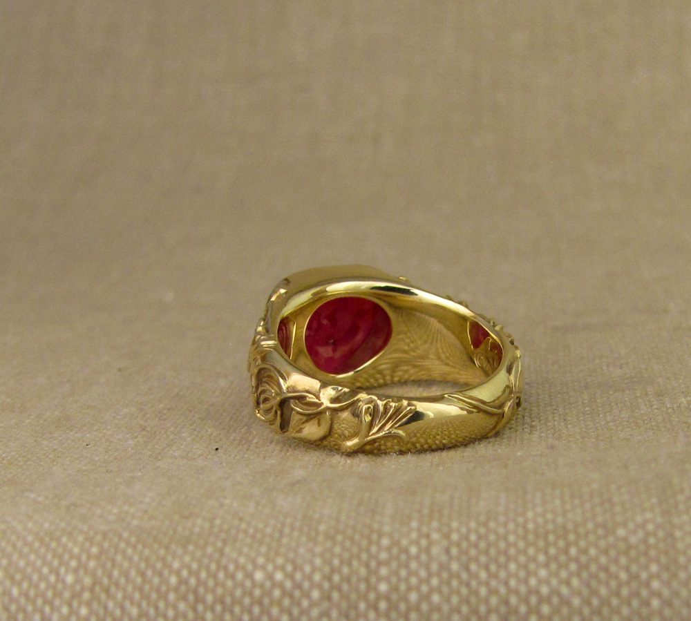 Custom designed & hand carved honeysuckle & bird motif solitaire, cabochon ruby pear, 18K yellow gold