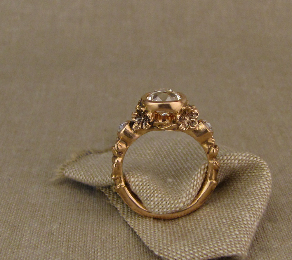 Custom designed & hand-carved Peach Blossom Solitaire bezel set with 1.39ct antique Old Mine Cut diamond, 19K rose gold.